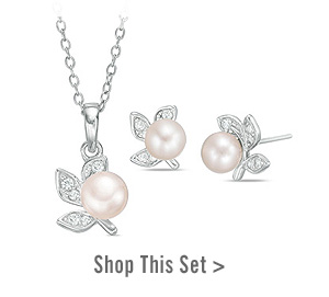 Cultured Freshwater Pearl and Lab-Created White Sapphire Floral Pendant and Stud Earrings Set in Sterling Silver. Shop This Style >